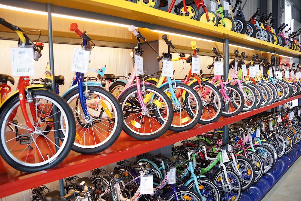 Kids Bike Test - Many different children's bicycles in the high rack in bicycle store