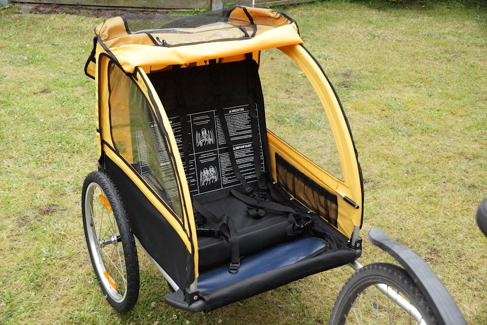 open M-Wave bicycle trailer behind a bicycle front